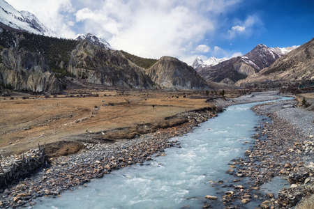 serene landscape: River and high mountains. Beautiful natural landscape