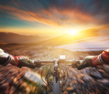 people in action: Fast ride on bike in mountain valley. Sport and active life concept