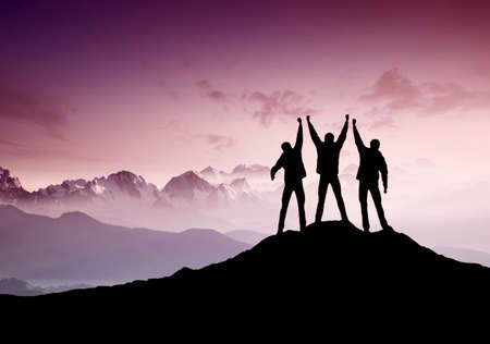 countryside landscape: Silhouettes of team on mountain peak. Sport and active life concept Stock Photo