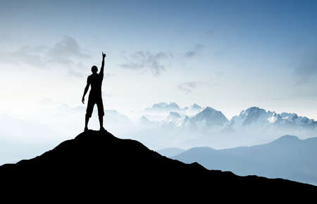 top mountain: Winner silhouette on the mountain top. Sport and active life concept Stock Photo