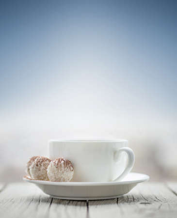 breakfast cup: Cup with coffee on the sky background. Breakfast concept and idea