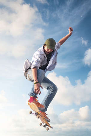 skateboarding tricks: Skater on the sky background. Sport and active life concept