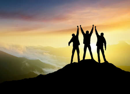 mountain man: Silhouettes of team on mountain peak. Sport and active life concept Stock Photo