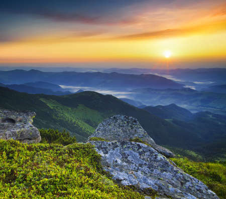wonderful: Grass and stone on the mountain hill during sundown. Beautiful summer landscape Stock Photo