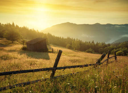 heaven background: Sun beam in mountain valley in the morning time during sunrise. Natural summer landscape
