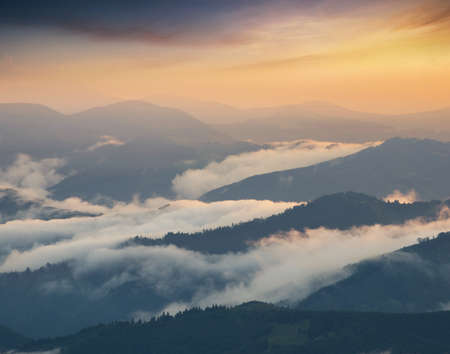 faintly visible: Mountain valley during sunrise. Natural summer landscape