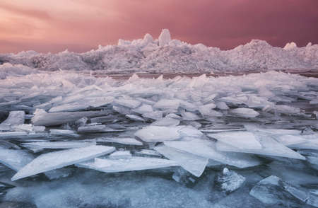 Frozen sea during sunset. Beautiful natural seascape in the winter time Stock Photo