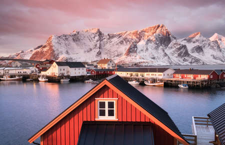 Houses in the Lofoten islands bay. Natural landscape during sunrise