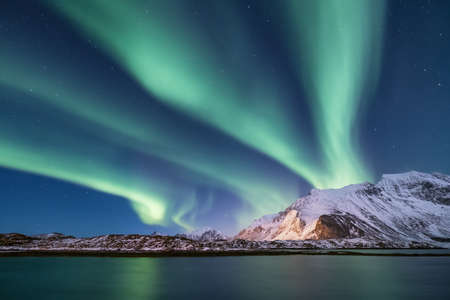 Northen light under mountains. Beautiful natural landscape in the Norway 写真素材