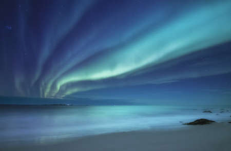 Northen light under beach. Beautiful natural landscape in the Norway Stock Photo