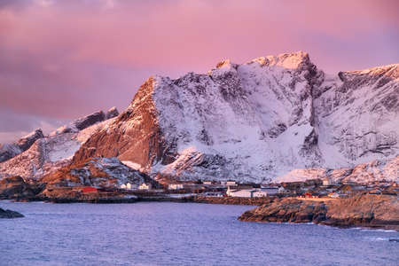 Mountains in the Lofoten islands bay. Natural landscape during sunrise Stock Photo