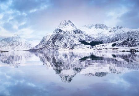 Mountain ridge and reflection at the water. Beautiful natural landscape in the Norway