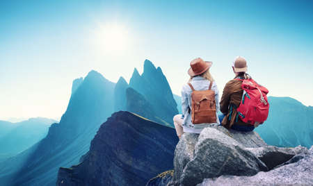 Travelers couple look at the mountains landscape. Travel and active life concept with team. Adventure and travel in the mountains region Reklamní fotografie