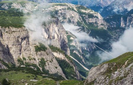 Mountain panorama in the Dolomite Alps, Italy. Mountain ridge in the clouds. Beautiful landscape at the summer time. Italy - image