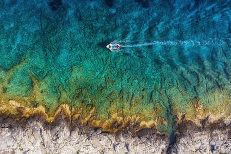 Croatia. Boat at the sea surface. Aerial view of  floating boat on blue Adriatic sea at sunny day. Travel - image Banco de Imagens