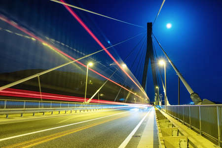 Blured lights from cars and bridge. Traffic background in the town. Composition with transport traffic. Transportation - image Banco de Imagens