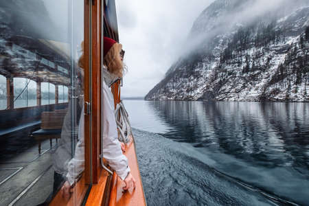 Woman walk on the boat on the lake. Travel and adventure in the Germany. Reflection on the water surface. Travel - Germany