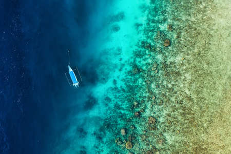 Boat on the water surface from top view. Azure water background from top view. Summer seascape from air. Travel - image