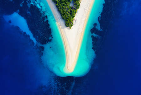 Croatia, Hvar island, Bol. Aerial view at the Zlatni Rat. Beach and sea from air. Famous place in Croatia. Summer seascape from drone. Travel - image Banco de Imagens