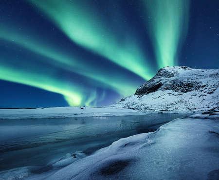 Aurora Borealis, Lofoten islands, Norway. Nothen light, mountain and frozen ocean. Winter landscape at the night time. Norway - image