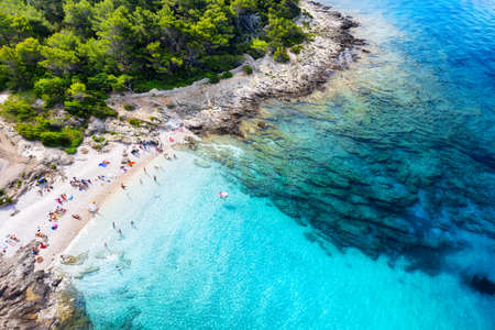Aerial view on the beach, stones and azure sea. Beach and sea from air. Summer seascape from drone. Croatia landscape. Travel - image