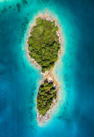 Aerial view on islands on sea. Seascape from air on the summer time. Azure water and islands with forest. Travel - image Banco de Imagens