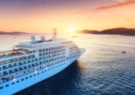 Aerial view at the cruise ship during sunset. Adventure and travel.  Landscape with cruise liner on Adriatic sea. Luxury cruise. Travel - image