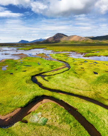 Iceland. Aerial view on the mountain, field and river. Landscape in the Iceland at the day time. Landscape from drone. Travel - image