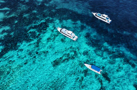 Boats on the water surface from top view. Azure water background from drone. Summer seascape from air. Travel - image
