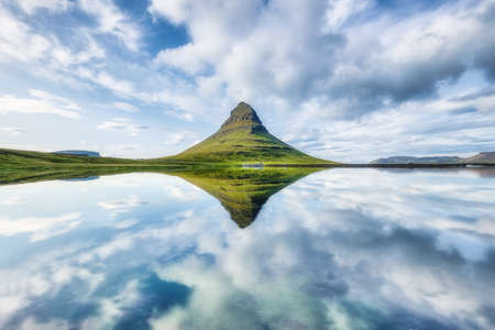 Kirkjufell. Mountains and lake in the Iceland. Natural landscape in the summer. Reflection on the water surface. Famous place. Iceland travel - image