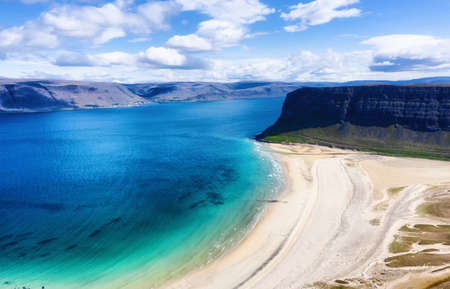 Iceland. Aerial view on the coast line, mountains and ocean. Beach and sea from air. Famous place in Iceland. Summer seascape from drone. Travel - image Banco de Imagens