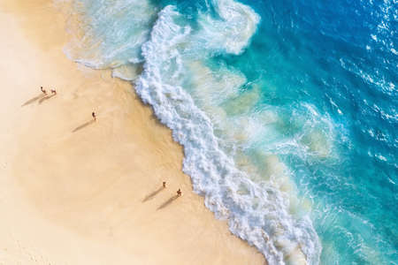 Beach, people and waves. Coast as a background from top view. Blue water background from drone. Summer seascape from air. Nusa Penida island, Indonesia. Travel - image