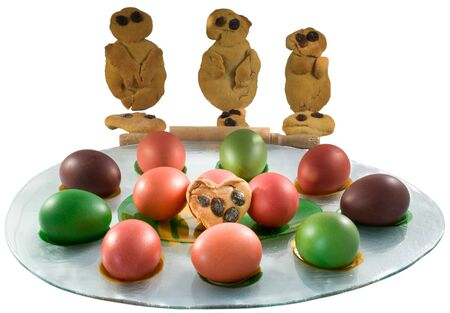 moulder: Traditional Greek cookies Lazarakia with Easter colored eggs.