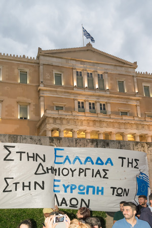 upcoming: Athens, Greece, 30 June 2015. Greek people demonstrated against the government about the upcoming referendum. People in the demonstration are in favor of voting yes in the referendum. Editorial
