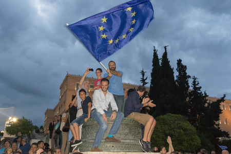 demonstrated: Athens, Greece, 30 June 2015. Greek people demonstrated against the government about the upcoming referendum. People in the demonstration are in favor of voting yes in the referendum. Editorial