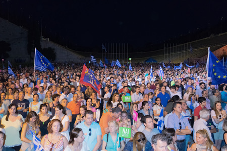 protesters: Athens, Greece, 3 July 2015. The mayor of Athens, Greek celebrities and people from all around Greece were gathered at Kallimarmaro stadium to demonstrate against the upcoming referendum. All protesters in the demonstration are in favor of voting YES in t