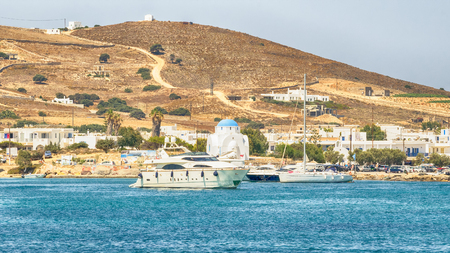 Antiparos port in Greece with a traditional white church standing in the middle.