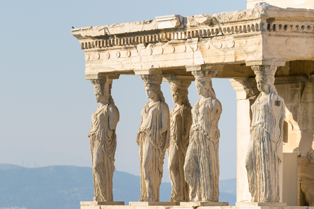 caryatids: Caryatids at Acropolis in Greece against the sky.