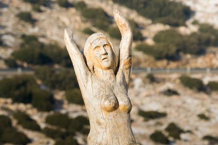 supplication: Athens, Greece 02 January 2016. Supplication wood carving at the park of lost souls Parko Psychon at Parnitha mountain.