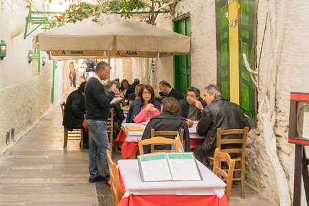 nafplio: Nafplio, Greece 27 December 2015. Traditional tavern at Nafplio in Greece with people having their lunch.