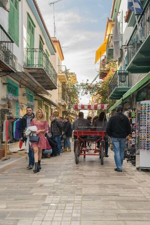 nafplio: Nafplio, Greece 27 December 2015. Traditional alley in Nafplio with people and tourists walking and enjoying their free time.