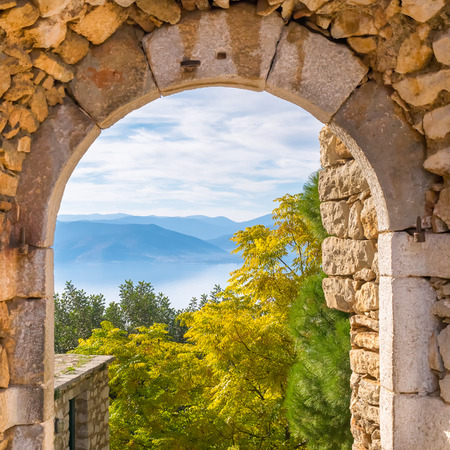 nafplio: Beautiful landscape at Nafplio in Greece through the old arched stoney doorway of Palamidi castle. Stock Photo