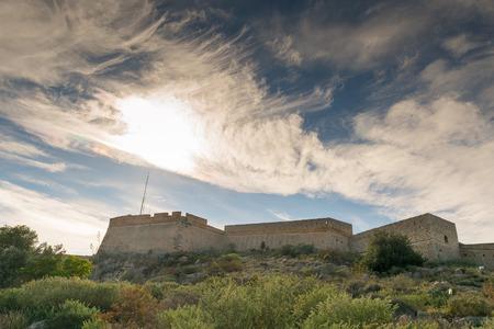 nafplio: Palamidi fort at Nafplio Greece against a dramatic sky.
