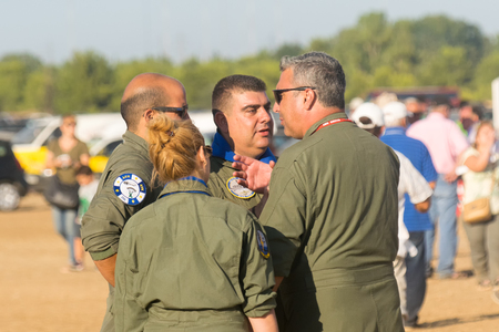 pilotos aviadores: Athens, Greece 13 September 2015. Air force pilots are discussing at the Athens flying week air show.