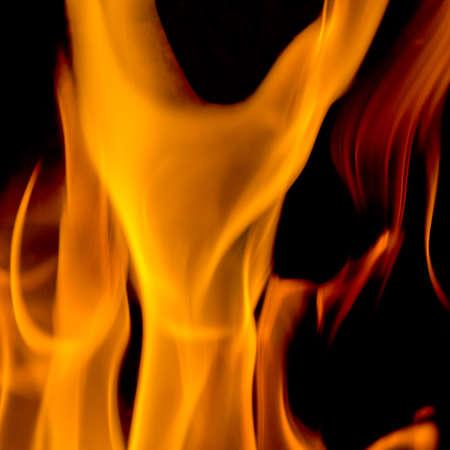 flame like: Fire flame having a shape like a dress on black. Stock Photo