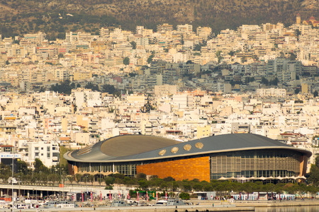 tae: Athens, Greece 7 Jume 2016. Tae kwon do stadium in Greece Piraeus. Landscape view of the city with the stadium as foreground. Editorial