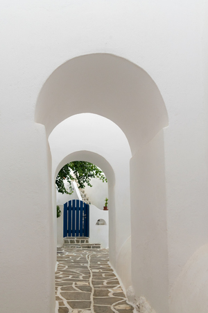 doorways: Arched doorways leading to a blue door. Traditional architecture of local villages at Paros island in Greece.