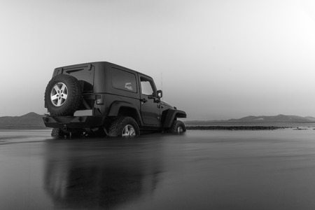 Athens, Greece 1 July 2016. Jeep 4x4 in black and white. Jeep got stuck in the mud at a wetland.