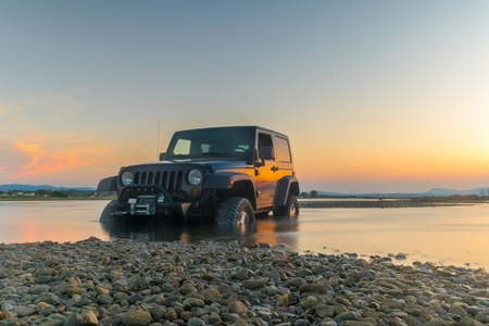 drive through: Athens, Greece 1 July 2016. Jeep 4x4 against the sunset. Jeep got stuck in the mud.