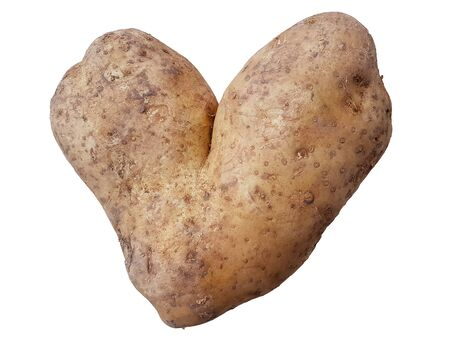 Potatoe in the shape of a heart isolated on white. A funny view.